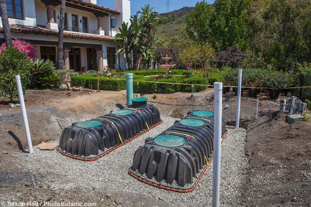 Stone garden installing cisterns in water conserving Southern California garden; design Urban Water Group