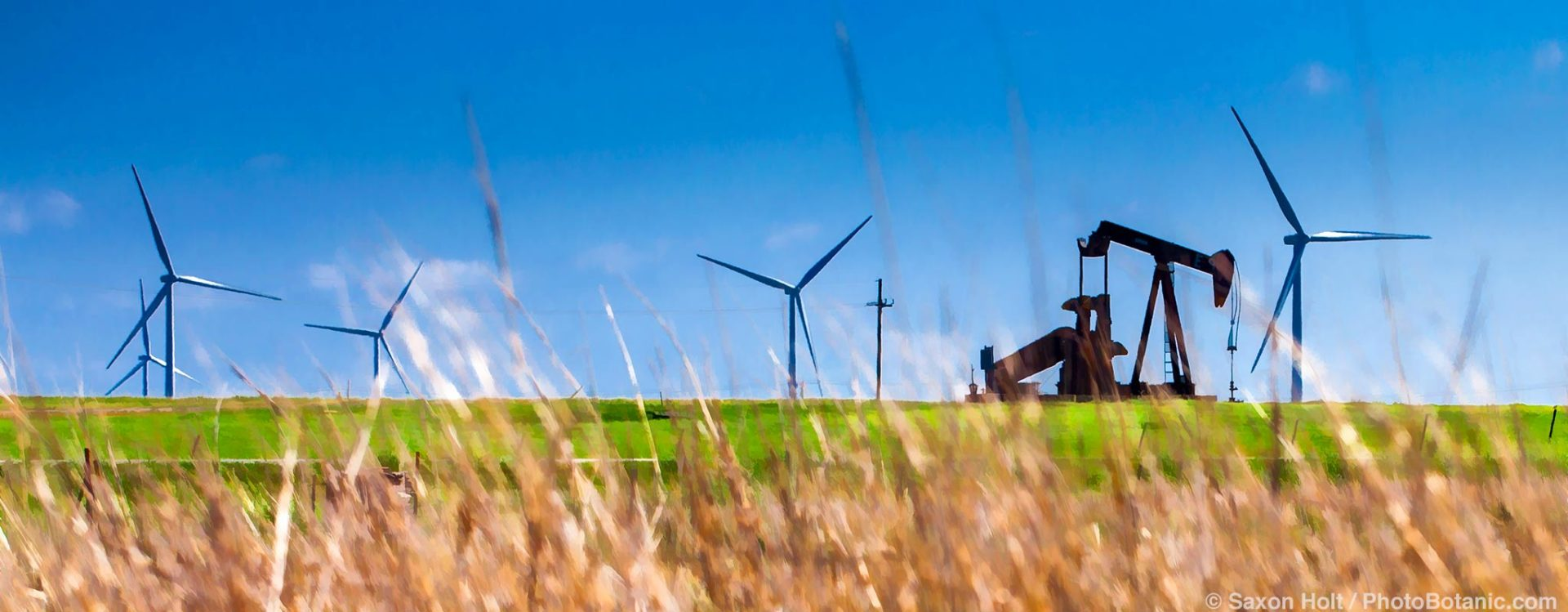 Energy old and new; Windfarm and Oil rig on the prairie